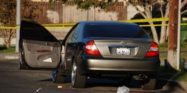 Photo of drive-by shooting is illustrative and via Chris Yarzab/Flickr.