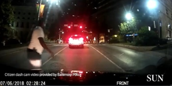 Screen grab of citizen dash-cam video of a man with a gun in Baltimore. Image courtesy of the...
