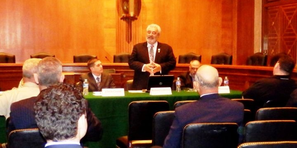 Richard Valdemar speaks in the U.S. Senate offices about Senate Bill 744 in April. Photo...