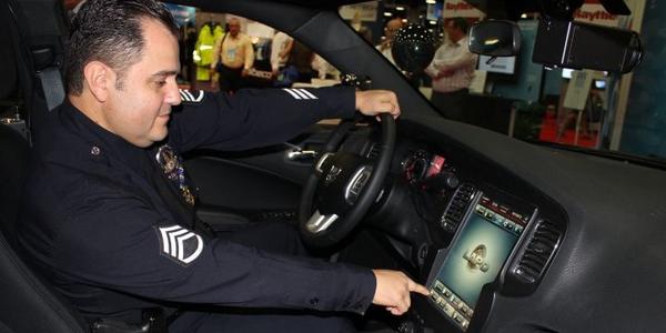 Sgt. Dan Gomez shows off the LAPD's next-gen Dodge Charger. Photo: Paul Clinton