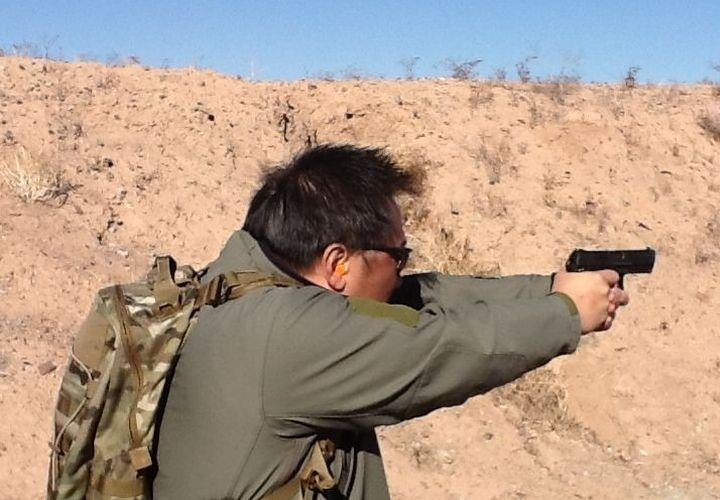 A media day participant shoots the HK45 Compact Tactical.  -