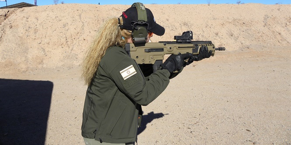 An IWI representative demonstrates the Tavor 95.