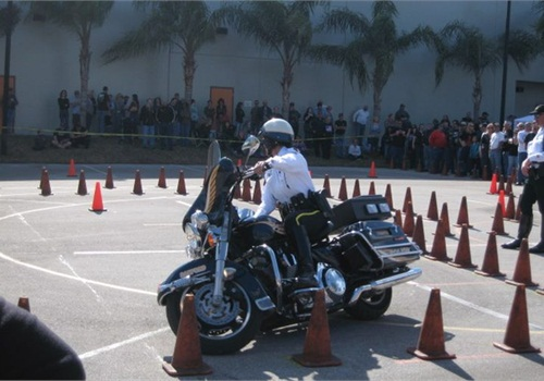 Sanford (Fla.) PD's Officer Tina Leman weaves through traffic cones on her H-D Electra Glide at a training rodeo. Photo courtesy of Officer Tina Leman.