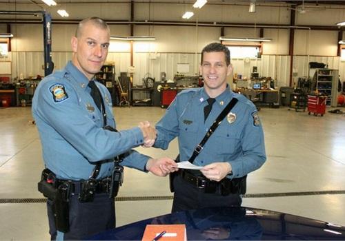 Trooper Michael Winner (left) accepts the keys for the last Ford CVPI issued for patrol fromCapt. Scott Harrington.Photo: KHP
