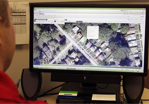 Officer Leake examines the GPS tracking trails of a sex offender. The green dots represent the subject's whereabouts. Placing the cursor over a box brings up the details box as shown. The detail box provides date and time, longitude and latitude, direction traveling, and speed traveling.