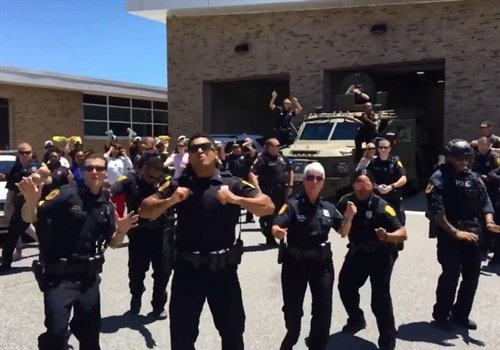 "Screen grab of the Norfolk (VA) Police Department's version of the Bruno Mars song ""Uptown Funk."" Image courtesy of Norfolk PD / Facebook."