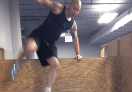 Officer Purkiss scales a six-foot wall 50 times to warm up for his workout.Photo: Josh Purkiss
