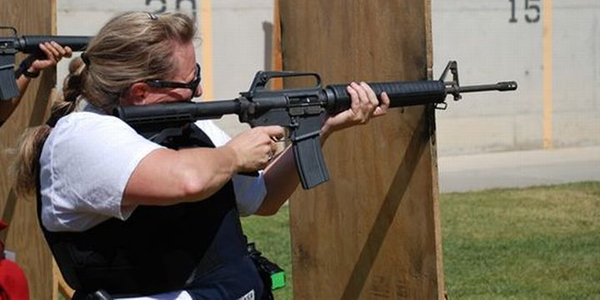 Sgt. Diana Drummey fires an AR-style rifle at the Coronado (Calif.) Police Department's range.