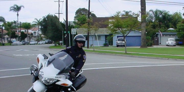 Coronado (Calif.) police motor officer David Craig makes a u-turn, while on patrol.