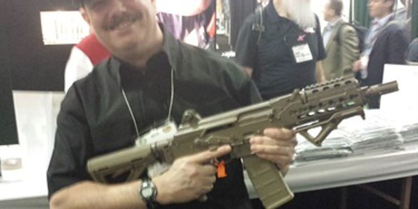 Retired officer and Police Magazine contributor Gerard Zlotkowski holds a new AK variant at SHOT...