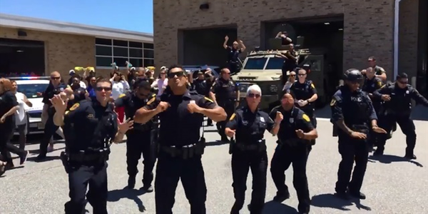 """Screen grab of the Norfolk (VA) Police Department's version of the Bruno Mars song """"Uptown..."""