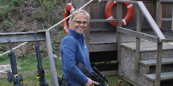 The author gets herself ready for a shooting competition with her carbine. Photo courtesy of...