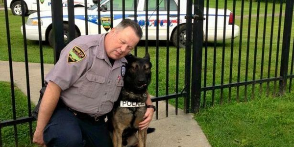 Officer Matthew Hickey with Ajax (Photo: Facebook)