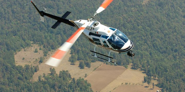 The Dallas Police Department uses Bell 206B3 helicopters similar to the one seen in this photo...