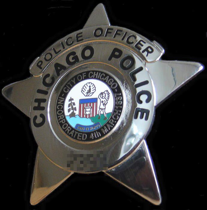Reputed Gang Member Charged in Shooting of 2 Chicago Officers