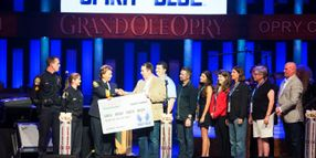 Spirit of Blue Presents Grant to Franklin PD on Grand Ole Opry Stage