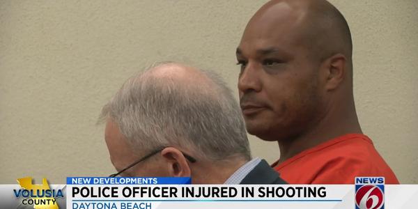 Investigators saidRaymond Roberts, 40,was walking around with the rifle, andwhen police...