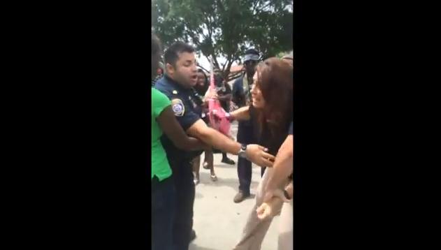 Police Detain Vet, Former Playboy Model After She Tries to Prevent Flag Desecration