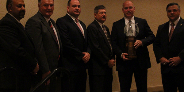 Members of the Missouri State Highway Patrol Rural Crimes Investigative Unit stand with their...
