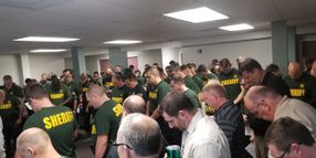 Photo: Florida Sheriff's Deputies Pause in Prayer Before Hurricane Makes Landfall