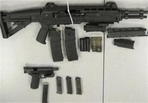 Photo released by the San Bernardino (Calif.) Sheriff's Department shows weapons recovered during the shooting investigation.