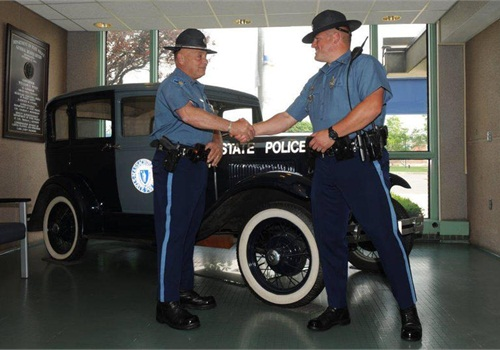 State troopers Philip Kucha, right, and Al Balestra meet again after Balestra rescued an ill Kucha when he was an infant in 1983. (Photo: Massachusetts State Police)