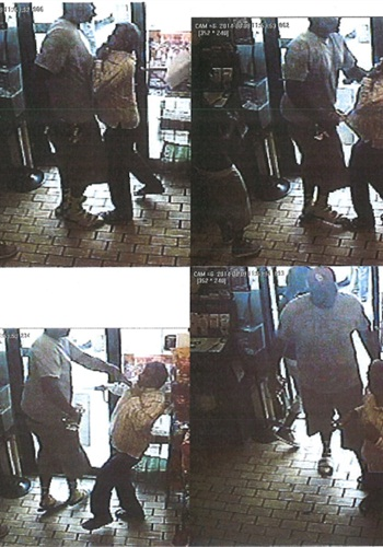 Surveillance video stills reportedly show a strong-arm robbery in a Ferguson, Mo., convenience store. Michael Brown was, according to police reports released today, a suspect in the robbery. Minutes after the incident in the store, Brown was shot and killed by a Ferguson police officer. (Photo: Ferguson PD)
