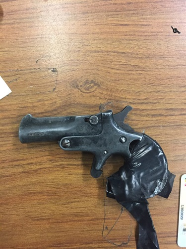 Baltimore police say they arrested a man for having this antique or replica antique firearm in his car. The man was legally prohibited from owning a firearm. (Photo: Baltimore PD)