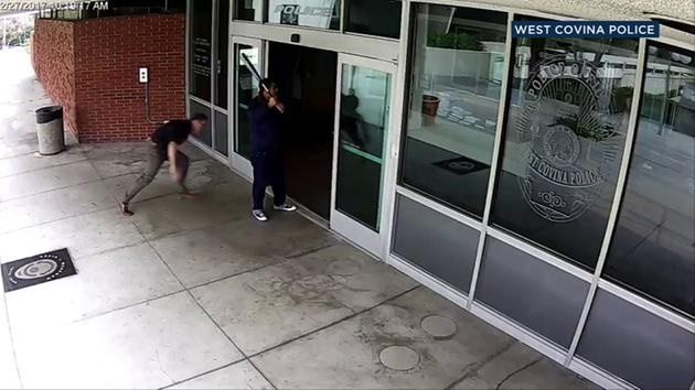 Surveillance image shows a man with a bat outside the West Covina, CA, police station. (Photo: West Covina PD)