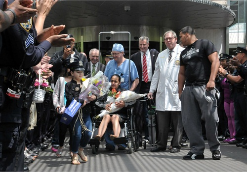 NYPDOfficer Rosa Rodriguez with family and supporters as she is released from the hospital. (Photo: Facebook)