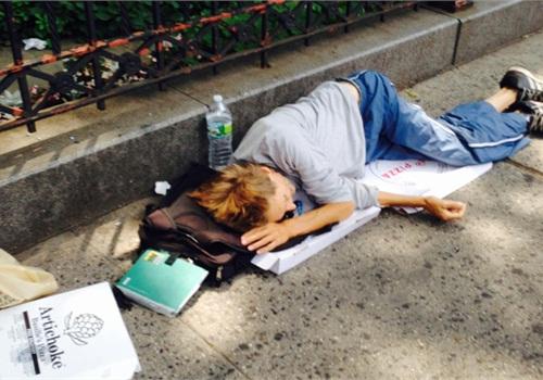 Homeless man sleeping on the street in New York City. (Photo: SBA via Flicker)
