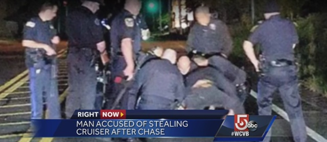 Massachusetts officers arrest a suspect who reportedly stole a patrol vehicle and led them on a pursuit. (Photo: WCVB Screen Shot)