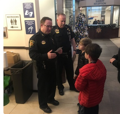 The two boys came to the Douglas County (CO) Sheriff's Office to donate their allowances to the family of a fallen deputy. (Photo: DCSO/Twitter)