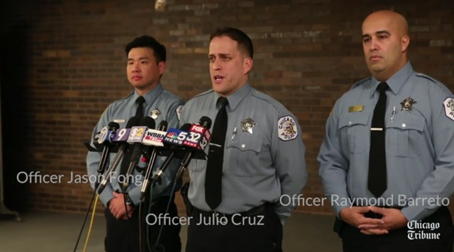 Chicago officers ran into a burning building looking for any residents trapped inside.