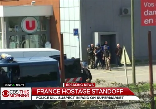A French policeman was shot by a gunman Friday after swapping himself for a hostage in a siege at a supermarket in the southwest town of Trebes. (screenshot: CBS News)