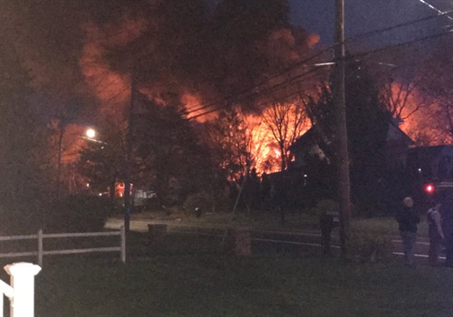 At least 9 officers were injured when a barn exploded behind a house where police were negotiating with a man after a violent domestic incident in North Haven, CT. Photo: WFSB screenshot