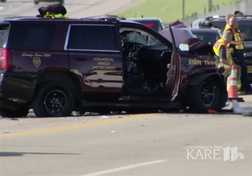 "The state patrol originally tweeted the trooper was ""pinned"" and had to be ""extricated"" from his vehicle. (Photo: KARE screenshot)"