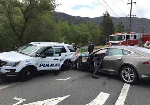 The Tesla sedan veered and struck the police SUV. Photo: Laguna Beach PD PIO/Twitter