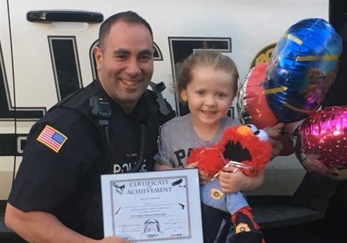 After gifting her doll to a Blasdell (NY) PD officer, Gabby now has Elmo back in her room and she says she wants to be a police officer when she grows up. (Photo: Blasdell PD)