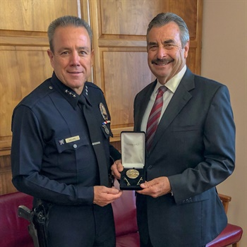 Michel Moore has been sworn in as the new chief of the LAPD. Here he is seen with outgoing chief Charlie Beck. Photo: LAPD Chief Michel Moore/Twitter