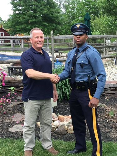 Retired Piscataway Police Officer Matthew Bailly was recently stopped by New Jersey Trooper Michael Patterson. Bailly helped deliver Michael Patterson in 1991. (Photo: New Jersey State Police)