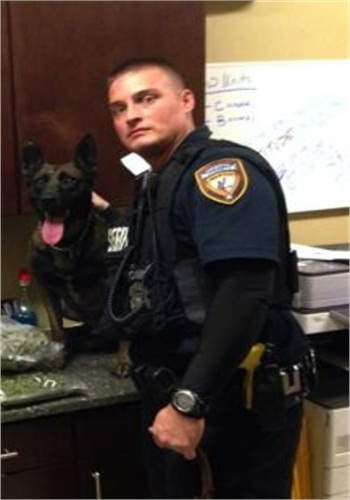 Deputy Jason Denham and his canine partner Sjors. (Photo: Harris County Sheriff's Office)