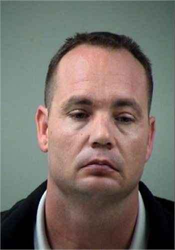 Booking photo of Officer Jackie Len Neal. Photo: Bexar County (Texas) Sheriff's Department