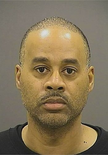 Booking photo of OfficerCaesar R. Goodson Jr. (Photo: Baltimore PD)
