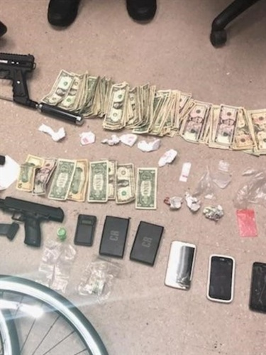 Some of the weapons, drugs, and cash New Jersey authorities recovered while investigating a threat against an Asbury Park police officer. (Photo: Asbury Park PD)