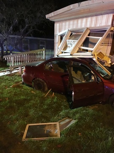 A suspect fleeing from an Oakland County (MI) Sheriff's deputy crashed into this mobile home Sunday. (Photo: Oakland County SO)