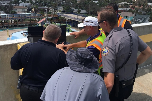 DBPD officers assess information collected from drones. (Photo courtesy of Embry-Riddle Aeronautical University.)