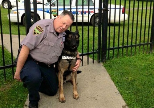 Officer Matthew Hickey served as Ajax's handler for three years. (Photo: Facebook)