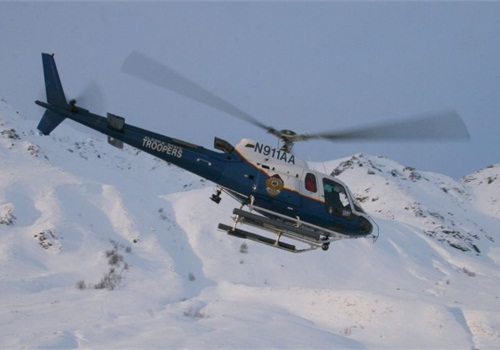 Helo 1 flies in Hacher Pass in 2007. Photo courtesy of Alaska State Troopers.