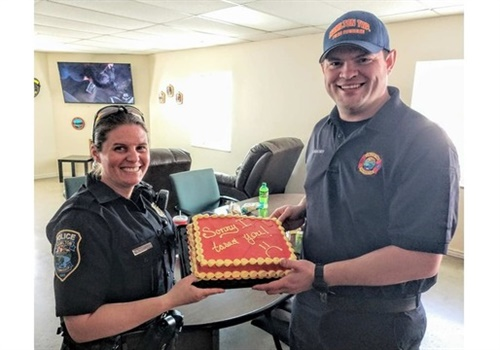 An Ohio officer gave an apology cake to a firefighter she accidentally shocked. (Photo: Hamilton Township Police/Facebook)